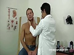 The young man sits in the exam chair in front of his doctor and he loves the exam that sees ...