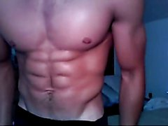 Hot muscular hunk gets hot and sweaty stripping and jerking on webcam.