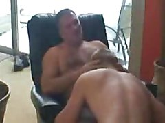 The blonde son and the daddy smoking a cigar are about to have some fun. Daddy takes his clo...