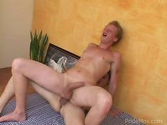 A hot blonde hunk rides a big pecker like a true cowboy.