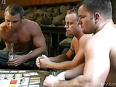 After playing a board game, these three men strip down nude and swap oral sex.