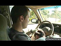 A hansome man driving a car picks up an attractive jock