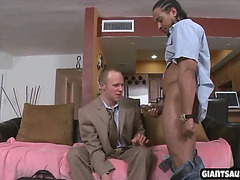a handsome business man gives a blow job to a big blck cock while wearing a suit