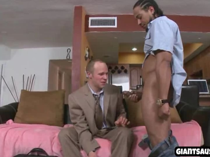 A business man gives blowjob to big black cock