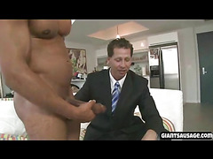a handsome muscular stud with big cock gets blowjob from stud in his bussiness suit