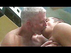 The sexy mature gay daddy shaves his boy's head and they fool around a bit before stepping i...