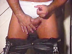 The leather bear with the thick body masturbates in his