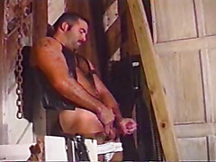 Leather daddy masturbates solo