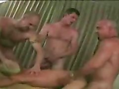 The blonde bottom submits to a gangbang in the hotel room and the guys use his mouth and ass...