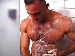 Hairy Muscle Daddy taking a shower at the gym spots a muscle boi in the sauna and a worker j...