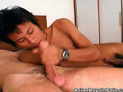 This hot asian stud enjoys sucking on his white friends cock.