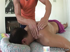 The young man with the tanned back lies on the massage