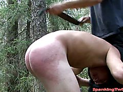 Horny master is having a wonderful time thrashing young gay studs butt until it is welting w...