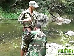 Two military lads resting by the river