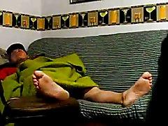 Black boy worshipping his master´s feet