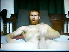 hung bearded red head cums a big load on cam