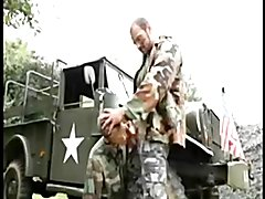 Military daddy fucks twink on the hood of a truck.