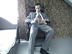 Jerking off solo in a suit