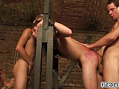 BDSM gay sex in dungeon with four horny twinks who play with dangerous toys! One blonde guy ...