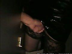 Crossdresser sucks off strangers cocks at the gloryhole