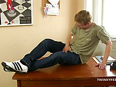 Justin Conway is sitting on his desk feeling foot fetish horny and decides to worship his fe...