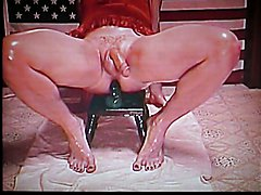 CD in Red playing with dildo and baby oil
