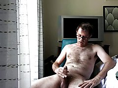 Wank and Cumshot in hotel room by window