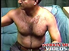 Hairy mature amateur Shawn solo plays with his cock on a bed
