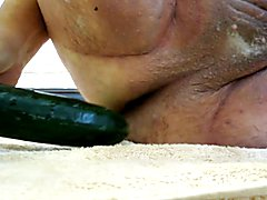 Getting opened by a zucchini squash and a cucumber.