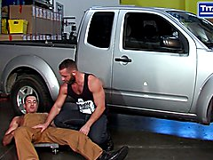 mechanic Nick Capra gets the attention of beefy Eddy