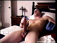Sprawled on the bed, straight boy Spike lubes up his
