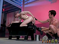 Men fisting and bondage gay Axel Abysse crouches on a going knuckle deep bench with his