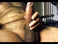 Playing with my big Latino uncut dick showing my ass