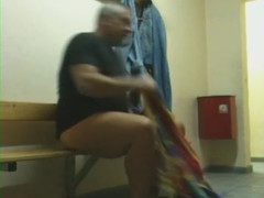 Thick old man in locker room
