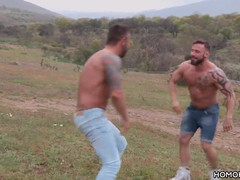 Sporty guys having sex countryside