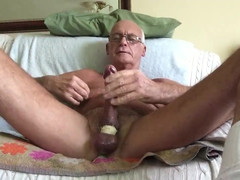Lovely tanned dad plays with himself with toy up his backside