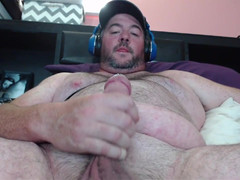 Thick gay bear erupts chubby load of hot seed