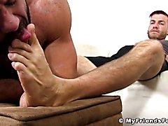 Tattooed jock toe sucked by a stud while masturbating his phat rod