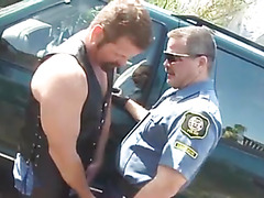 The bear cop in uniform pulls over a leather stud and