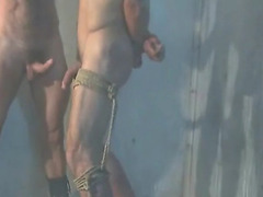 The dungeon allows for play with their gay submissives in any way they please. That should a...
