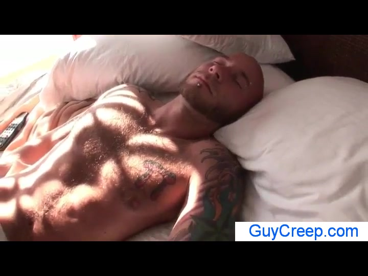 The hot guy with the hairy chest sleeps in bed
