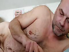 Chubby gay daddy cums