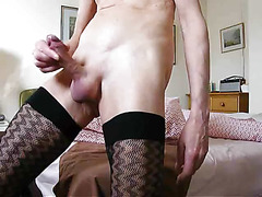 Crossdresser in stockings cums hard
