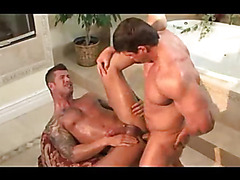 Watch the hot hunk video set in the bathroom to see two