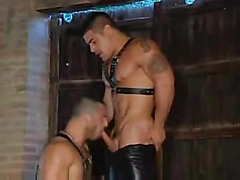 The leather hotties enter the warehouse and immediately